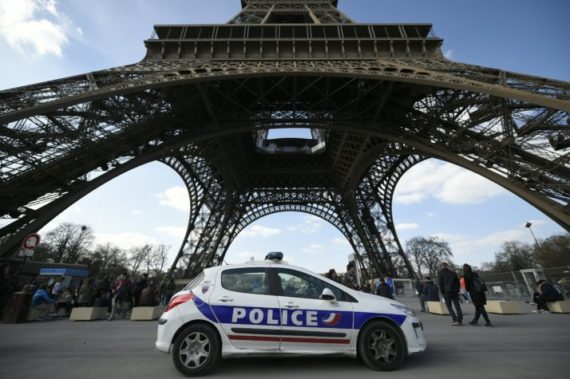 A police car is parked near the Eiffel tower, on March 22, 2016 in Paris. / AFP / LIONEL BONAVENTURE (Photo credit should read LIONEL BONAVENTURE/AFP/Getty Images)